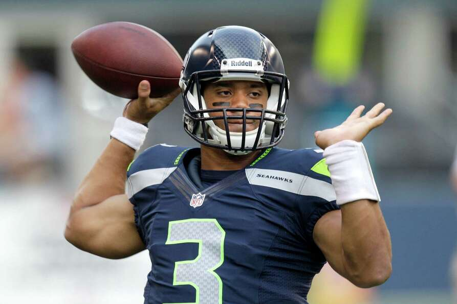 Seattle Seahawks quarterback Russell Wilson warms up before the NFL football game against the Green