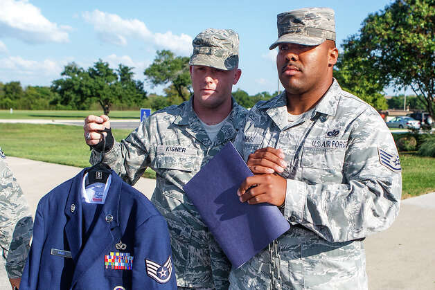 Staff sergeant, Airman 1st Class Jason Manko (right) is led from the courthouse to a waiting pickup on Joint Base San Antonio-Lackland on Sept. 24, 2012 after being sentenced to 45 days in jail and another 30 days of hard labor on the base. Manko, who could remain in the Air Force despite his conviction, did not reply when asked if he had anything to say.  MARVIN PFEIFFER/ mpfeiffer@express-news.net Photo: MARVIN PFEIFFER, Marvin Pfeiffer/ Express-News / Express-News 2012