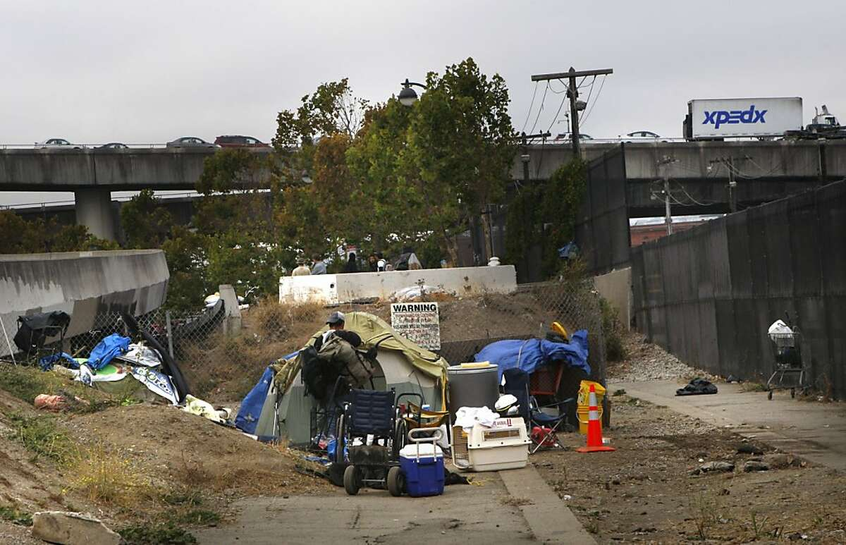 A man moving some of his belongings at a homeless encampment under highway 280 on King at Fifth streets in San Francisco, Calif., on Monday, September 24, 2012.