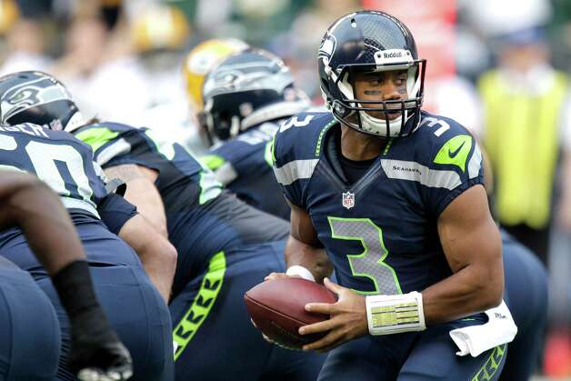 Seattle Seahawks quarterback Russell Wilson sets to hand off the ball in the first half of an NFL football game against the Green Bay Packers, Monday, Sept. 24, 2012, in Seattle. Photo: AP