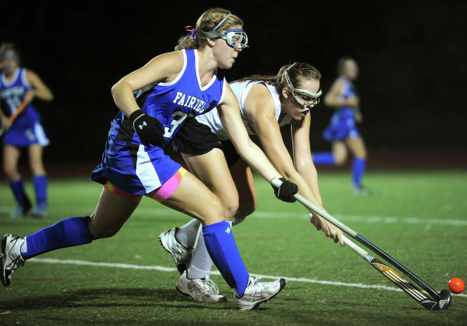 Ludlowe defender Sydney Shaffer, left, fights for control of the ball with Warde's Emily Allen during their varsity field hockey matchup at Warde High School in Fairfield on Monday, September 24, 2012. Photo: Brian A. Pounds / Connecticut Post