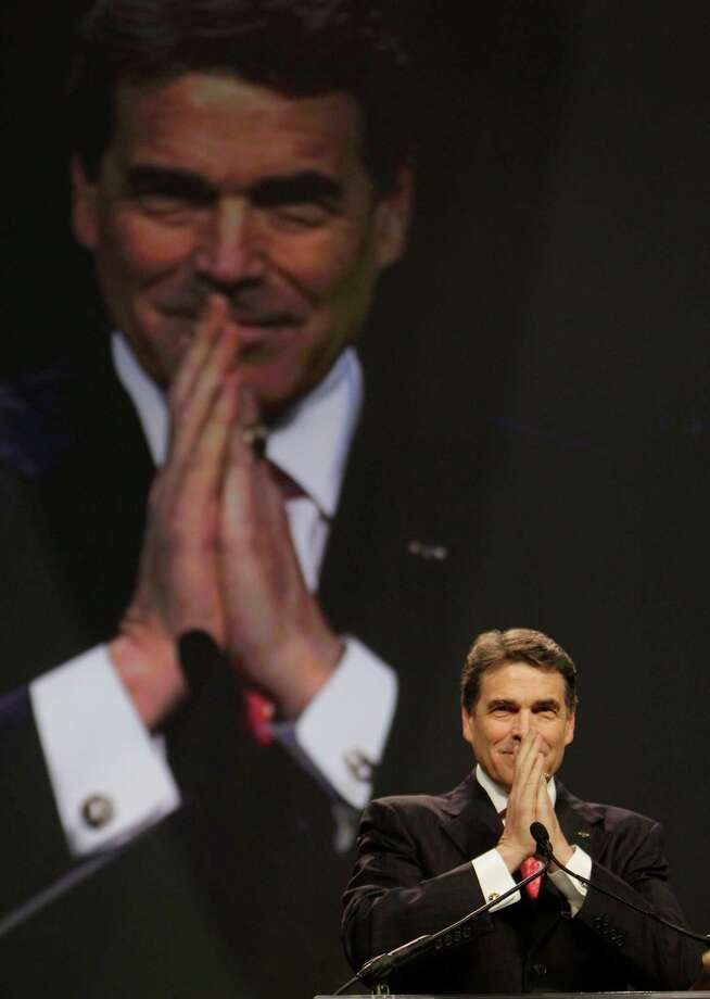 Texas Gov. Rick Perry read Scripture and gave a prayer during a seven-hour program at Reliant Stadium last year. Photo: Melissa Phillip / 2011 Houston Chronicle