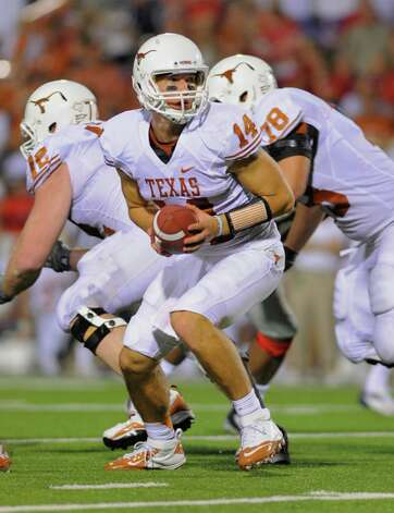 Texas quarterback David Ash prepares to make a handoff during the first quarter of an NCAA college football game in Oxford, Miss., Saturday, Sept. 15, 2012. No. 14 Texas won 66-31. (AP Photo/Austin McAfee) Photo: Austin McAfee, Associated Press / AP