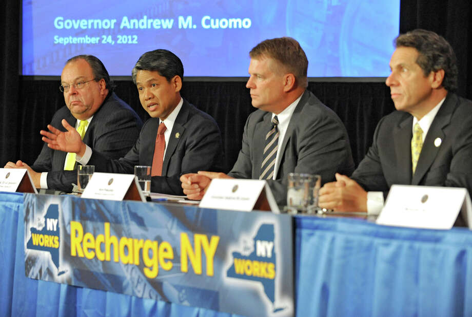 Gil Quiniones, president and CEO NY Power Authority, second from left, talks about Governor Andrew Cuomo's power program ReCharge NY, during a press conference at the Capitol Monday, Sept. 24, 2012 in Albany, N.Y. Sitting with Quiniones, from left, is John Koelmel of NY Power Authority, Ken Pokalsky of the Business Council of NYS and Governor Andrew Cuomo.  (Lori Van Buren / Times Union) Photo: Lori Van Buren
