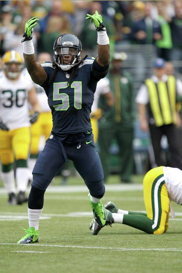 Seattle Seahawks Bruce Irvin celebrates after sacking Green Bay Packers quarterback Aaron Rodgers in the first half of an NFL football game, Monday, Sept. 24, 2012, in Seattle. Photo: Ted S. Warren, AP / AP