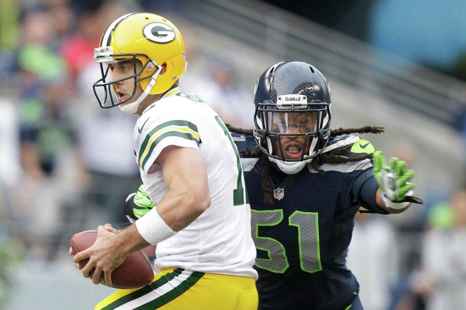 Green Bay Packers quarterback Aaron Rodgers is sacked by Seattle Seahawks Bruce Irvin in the first half of an NFL football game, Monday, Sept. 24, 2012, in Seattle. Photo: Stephen Brashear, AP / FR159797 AP