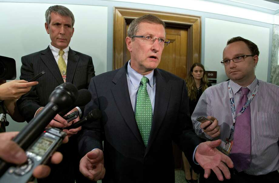 "Senate Budget Committee Chairman Kent Conrad, D-N.D., speaks with reporters after a meeting between Federal Reserve Chairman Ben Bernanke and members of the Senate Finance Committee to discuss the looming economic crisis, often called the ""fiscal cliff,"" a combination of tax increases and spending cuts that will kick in on Jan. 2, 2013, if Congress fails to act, in Washington, Wednesday, Sept. 19, 2012.  (AP Photo/J. Scott Applewhite) Photo: Associated Press / AP"