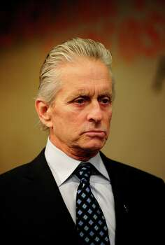 US Actor Michael Douglas attends the inauguration of a new art installation of civil society petitions calling for the abolition of nuclear weapons at the United Nations headquarters in New York, March 24, 2011. AFP PHOTO/Emmanuel Dunand (Photo credit should read EMMANUEL DUNAND/AFP/Getty Images) Photo: EMMANUEL DUNAND / AFP