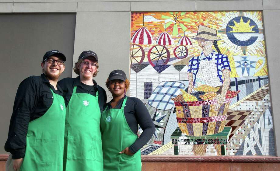 "Daniel Green, from left, Forrest Johnson and Jenora Armstrong work at the Starbucks ""community store"" on Woodridge, where a tile mural outside the coffeehouse pays tribute to the East End. Photo: Cody Duty / © 2012 Houston Chronicle"