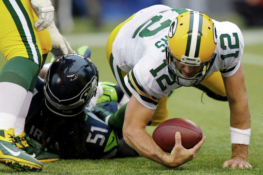 Seattle Seahawks defensive end Bruce Irvin (51) sacks Green Bay Packers quarterback Aaron Rodgers (12) for the second time in the first half of an NFL football game, Monday, Sept. 24, 2012, in Seattle. Photo: AP