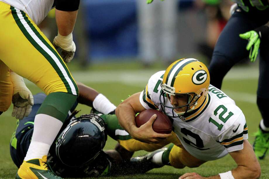 Seattle Seahawks linebacker Bruce Irvin, lower left, sacks Green Bay Packers quarterback Aaron Rodgers for the second time in the first half of an NFL football game, Monday, Sept. 24, 2012, in Seattle. Photo: AP