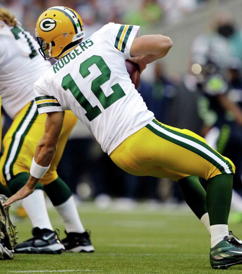 Green Bay Packers quarterback Aaron Rodgers slips and falls during the first quarter of the NFL football game against the Seattle Seahawks, Monday, Sept. 24, 2012, in Seattle. Photo: AP
