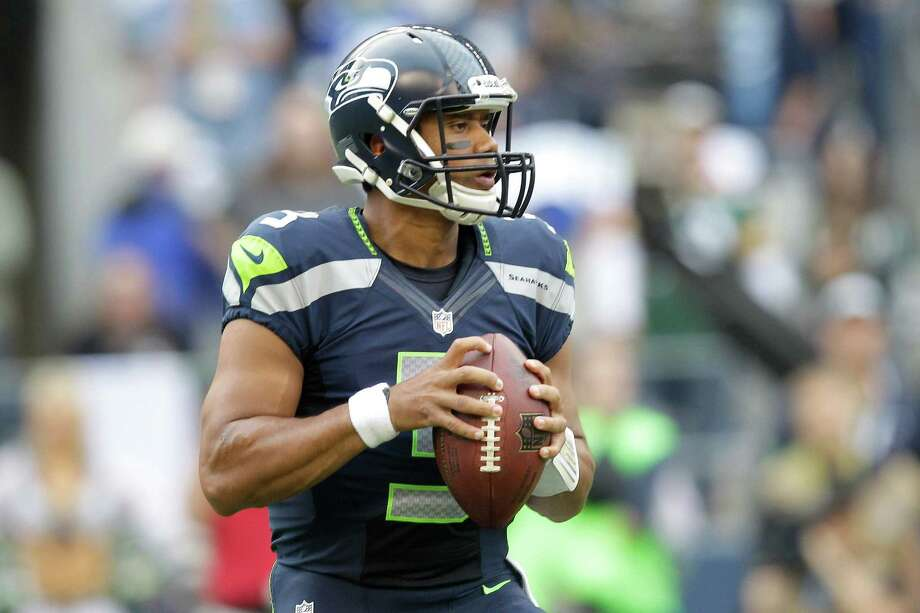 Seattle Seahawks quarterback Russell Wilson sets to pass in the first half of an NFL football game against Green Bay Packers, Monday, Sept. 24, 2012, in Seattle. Photo: AP