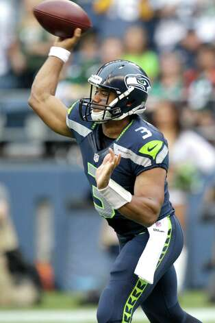 Seattle Seahawks quarterback Russell Wilson passes in the first half of an NFL football game against Green Bay Packers, Monday, Sept. 24, 2012, in Seattle. Photo: AP