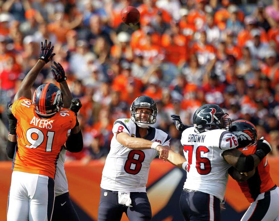 Texans quarterback Matt Schaub (8) shook off some stout hits by the Broncos to throw for 290 yards and four touchdowns - each to a different receiver - Sunday. Schaub's leadership role was evident in the win over Denver. Photo: Brett Coomer / © 2012  Houston Chronicle