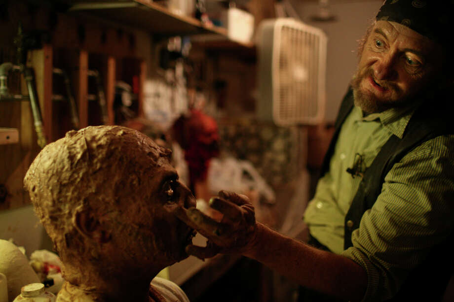 Bill Kopfler (right) finishes the makeup for Bruce McColley before McColley heads out to scare the crowd at Nightmare on Grayson in San Antonio on Thursday, Oct. 18, 2007. Photo: LISA KRANTZ, SAN ANTONIO EXPRESS-NEWS / SAN ANTONIO EXPRESS-NEWS