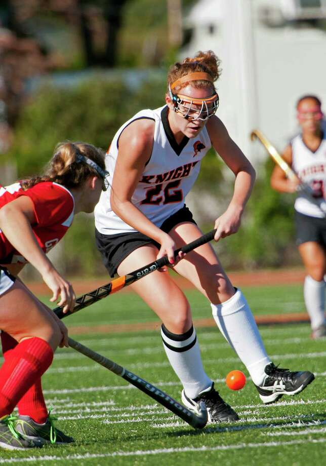 Stamford high school's Taylor Mills fights for the ball in a field hockey game against Greenwich high school played at Stamford high school on Monday September 24th, 2012. Photo: Mark Conrad / Stamford Advocate Freelance
