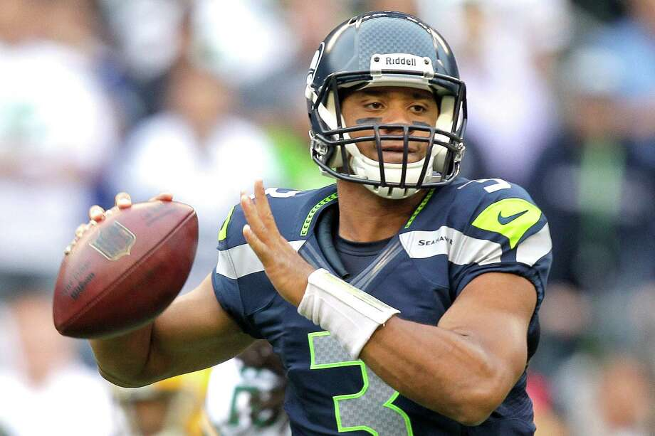 Seattle Seahawks quarterback Russell Wilson sets to pass in the first half of an NFL football game against the Green Bay Packers, Monday, Sept. 24, 2012, in Seattle. Photo: AP