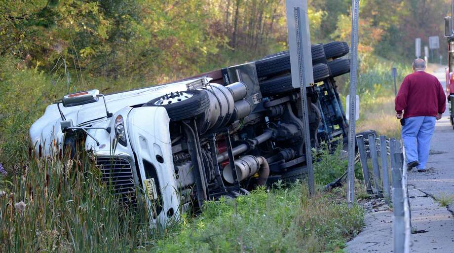 New York State Police investigated a tractor trailer rollover this morning on the Interstate 87 north of Exit 13 in Saratoga Springs, N.Y. Sept. 24, 2012.      (Skip Dickstein/Times Union) Photo: Skip Dickstein