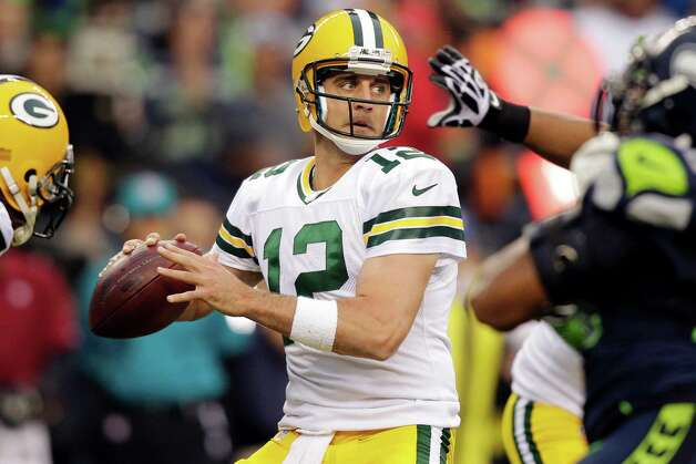Green Bay Packers quarterback Aaron Rodgers sets to pass against the Seattle Seahawks in the first half of an NFL football game, Monday, Sept. 24, 2012, in Seattle. Photo: AP