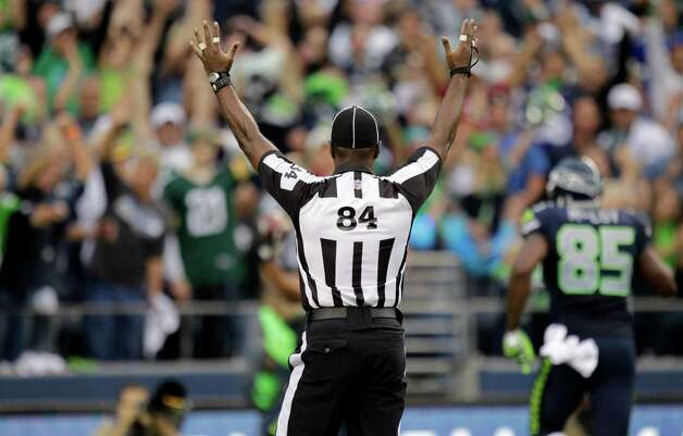 Official Derrick Rhone-Dunn (84) calls a Seattle touchdown during the first half of an NFL football game Green Bay Packers and Seattle Seahawks , Monday, Sept. 24, 2012, in Seattle. Photo: AP