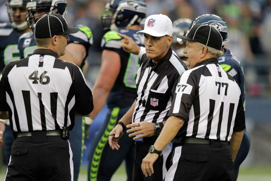 Officials Marc Harrod (46) and Mike Peek (77) talk during the first half of an NFL football game Green Bay Packers and Seattle Seahawks , Monday, Sept. 24, 2012, in Seattle. Photo: AP