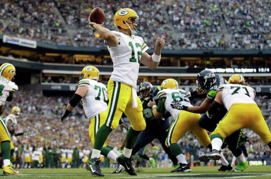 Green Bay Packers quarterback Aaron Rodgers (12) passes against the Seattle Seahawks in the first half of an NFL football game, Monday, Sept. 24, 2012, at CenturyLink Field in Seattle. Photo: AP