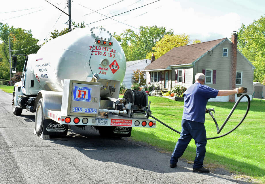Polsinello Fuels employee David Sanders deliver propane to a home on Monday, Sept. 24, 2012 in East Greenbush, N.Y. (Lori Van Buren / Times Union) Photo: Lori Van Buren