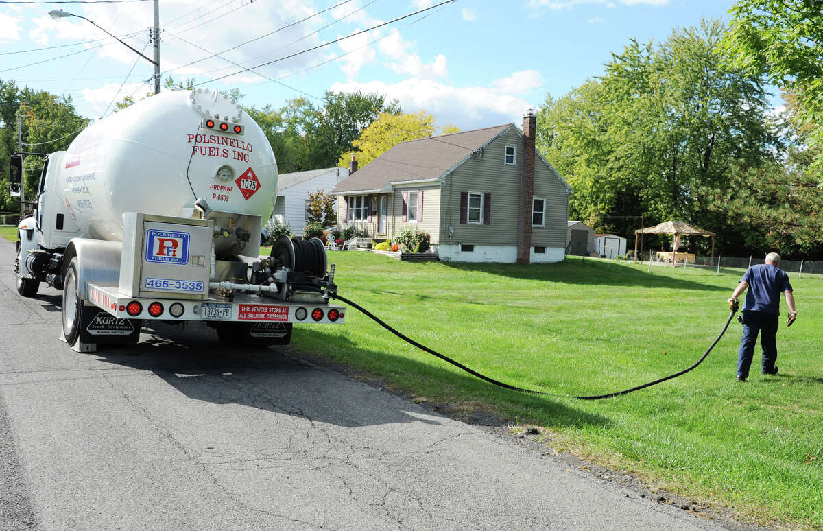 Polsinello Fuels employee David Sanders deliver propane to a home on Monday, Sept. 24, 2012 in East Greenbush, N.Y. (Lori Van Buren / Times Union)