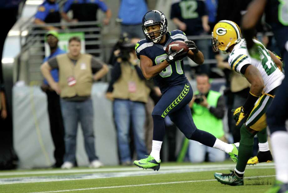 Seattle Seahawks wide receiver Golden Tate catches a touchdown against the Green Bay Packers in the first half of an NFL football game, Monday, Sept. 24, 2012, in Seattle. Photo: AP