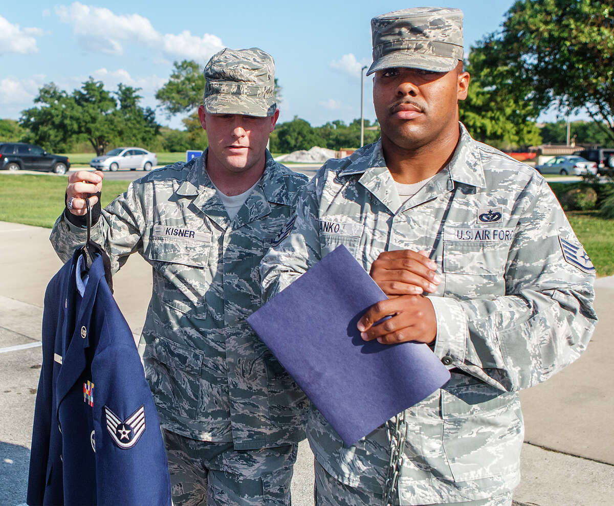 Airman 1st Class Jason Manko, right, is led from the courthouse on Monday after being sentenced to 45 days in jail and another 30 days of hard labor.