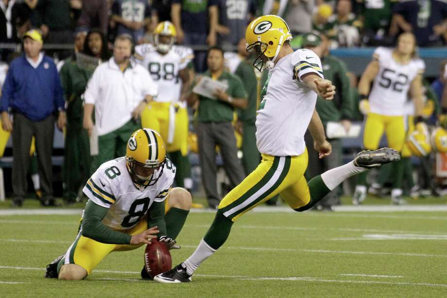 Green Bay Packers Tim Masthay (8) holds while place kicker Mason Crosby kicks a field goal against the Seattle Seahawks in the second half of an NFL football game, Monday, Sept. 24, 2012, in Seattle. Photo: AP