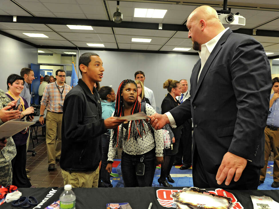 Jordan Goldberg, 15, of Albany gets and autograph from The Big Show, a WWE pro wrestler,who spoke to Albany High students Monday, Sept. 24, 2012 in Albany, N.Y. (Lori Van Buren / Times Union)