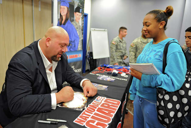 The Big Show, a WWE pro wrestler, signs an autograph for Shakeara Brown of Albany before he spoke to Albany High students Monday, Sept. 24, 2012 in Albany, N.Y.  (Lori Van Buren / Times Union) Photo: Lori Van Buren
