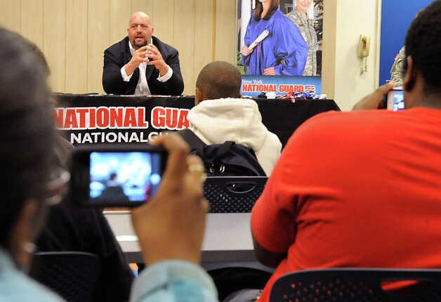 Students take video with their cell phones of The Big Show, a WWE pro wrestler, as he speaks to Albany High students Monday, Sept. 24, 2012 in Albany, N.Y.  (Lori Van Buren / Times Union) Photo: Lori Van Buren