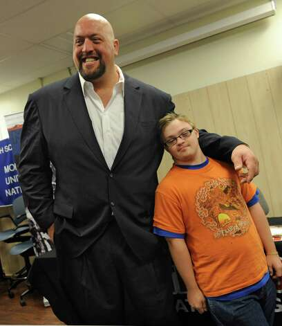 Luke Godin, 17, of Albany has his photo taken with The Big Show, a WWE pro wrestler,who spoke to Albany High students Monday, Sept. 24, 2012 in Albany, N.Y.  (Lori Van Buren / Times Union) Photo: Lori Van Buren
