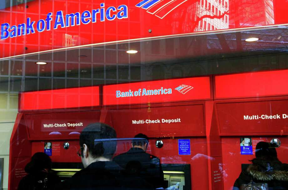Be aware of your surroundings. If you are using your card at a dimly-lit ATM, consider waiting to use another.  Photo: Mark Lennihan / AP