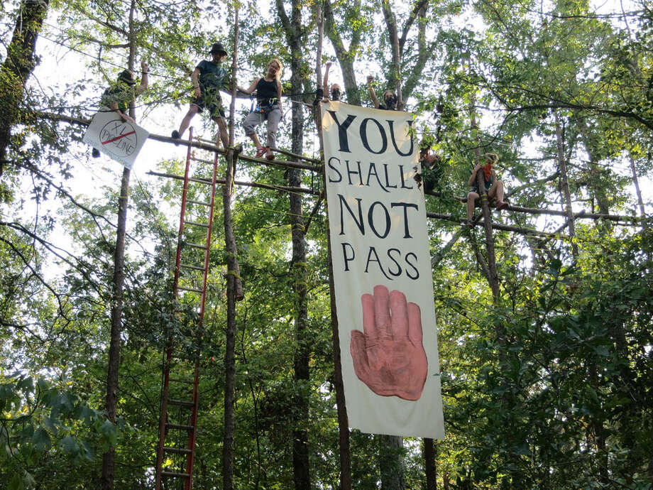 Protesters display a banner Monday in northeast Texas that voices their opposition to the southern portion of the Keystone XL oil pipeline. Protesters did not disrupt any work Monday, TransCanada spokesman David Dodson said.