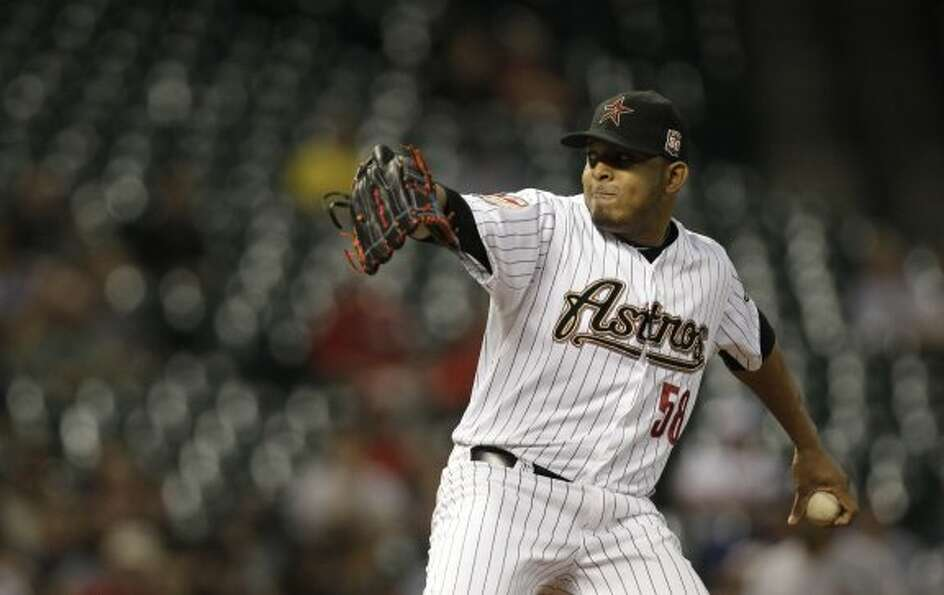 Fernando Abad delivers a pitch in the first frame. (Melissa Phillip / © 2012 Houston Chronicle)