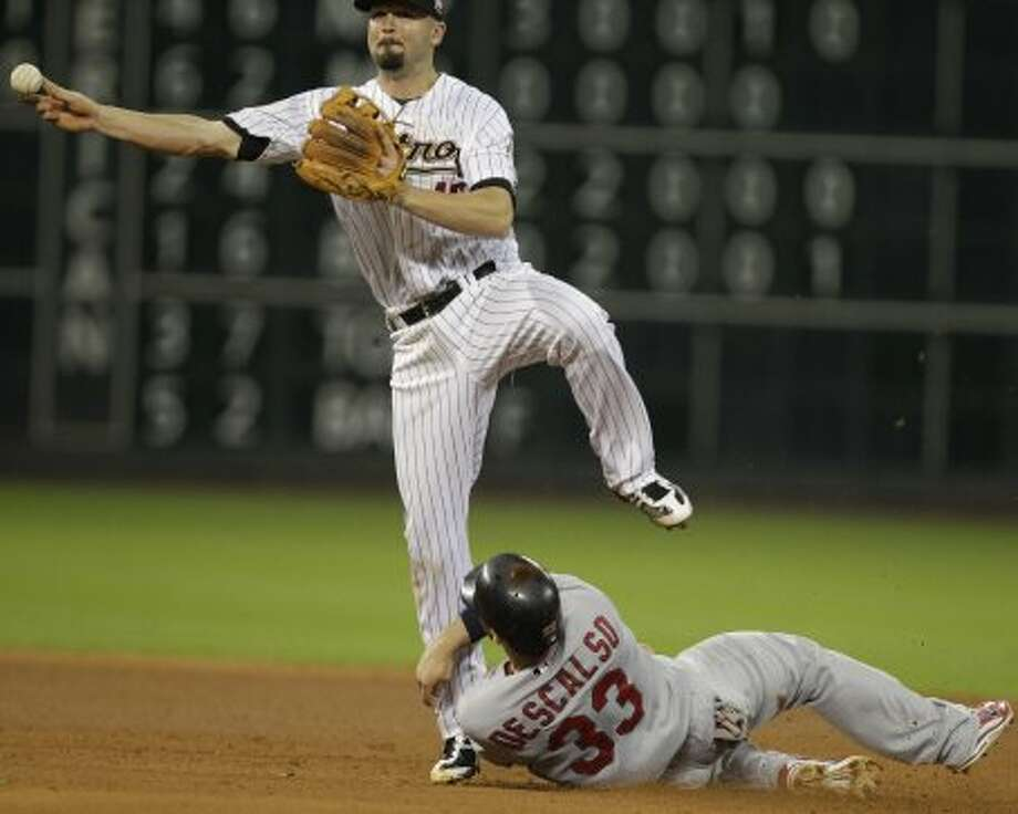Astros' Scott Moore throws to first base on a double play in the fourth inning. (Melissa Phillip / © 2012 Houston Chronicle)