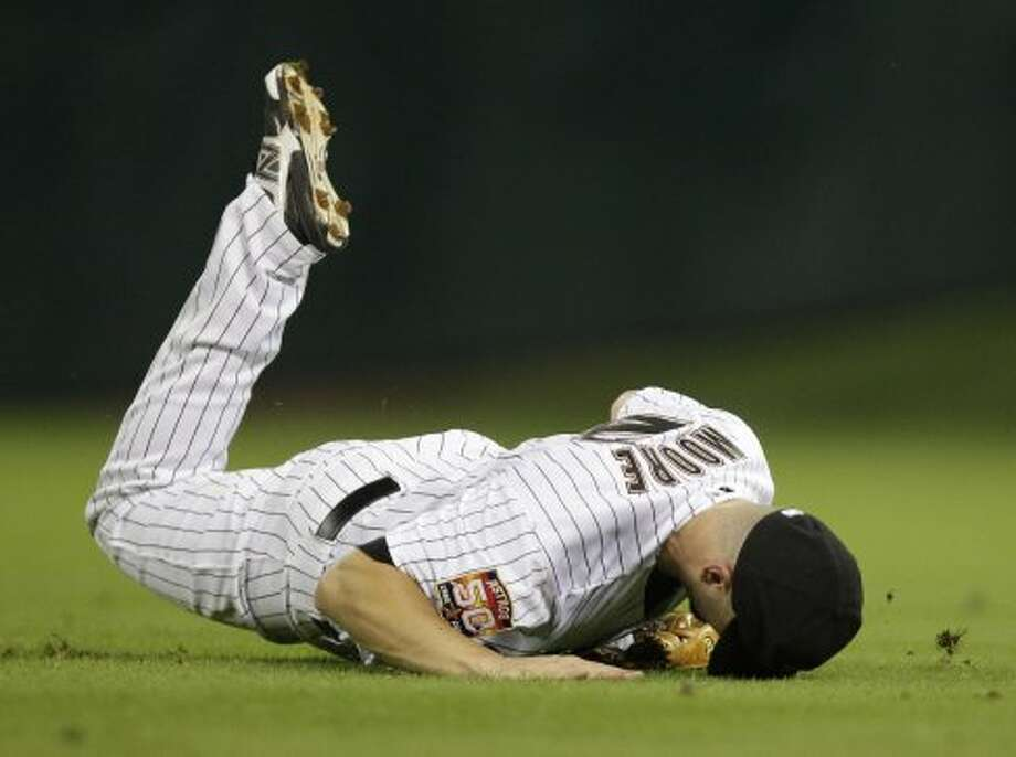 Scott Moore lands face-first after a missed diving catch attempt during the fourth inning. (Melissa Phillip / © 2012 Houston Chronicle)