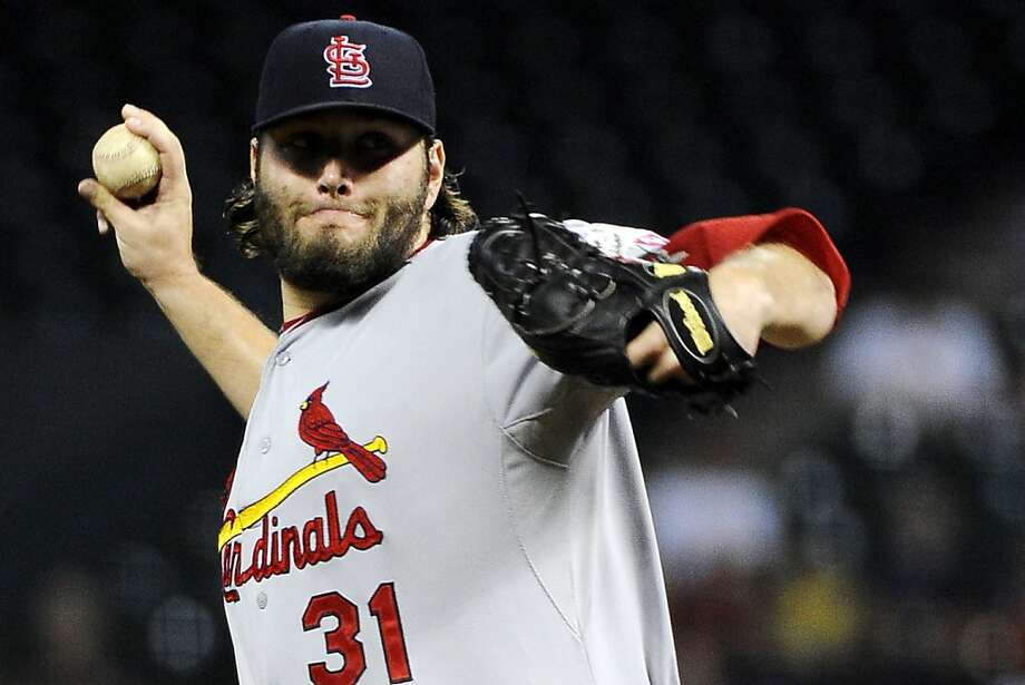 Lance Lynn, right, pitched seven innings to earn his 17th win, rookie Pete Kozma hit a two-run homer, and St. Louis strengthened its grip on a playoff spot. Photo: Pat Sullivan, Associated Press