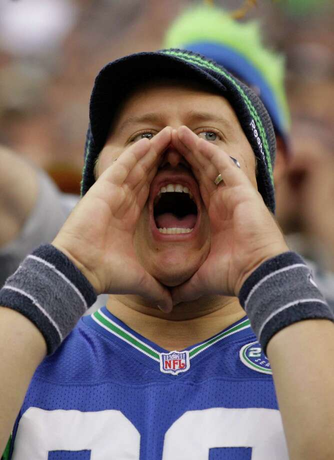 A Seattle Seahawks fan cheers in the first half of an NFL football game against the Green Bay Packers, Monday, Sept. 24, 2012, in Seattle. Photo: AP