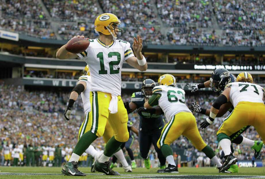 Green Bay Packers quarterback Aaron Rodgers (12) sets to pass against the Seattle Seahawks in the first half of an NFL football game, Monday, Sept. 24, 2012, in Seattle. Photo: AP