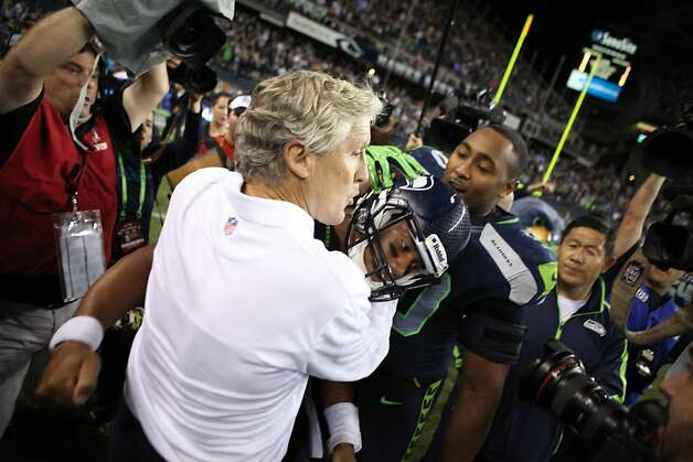 Quarterback Russell Wilson #3 of the Seattle Seahawks is congratulated by head coach Pete Carroll after defeating the Green Bay Packers at CenturyLink Field on September 24, 2012 in Seattle, Washington.  (Photo by Otto Greule Jr/Getty Images) Photo: Otto Greule Jr, Getty Images