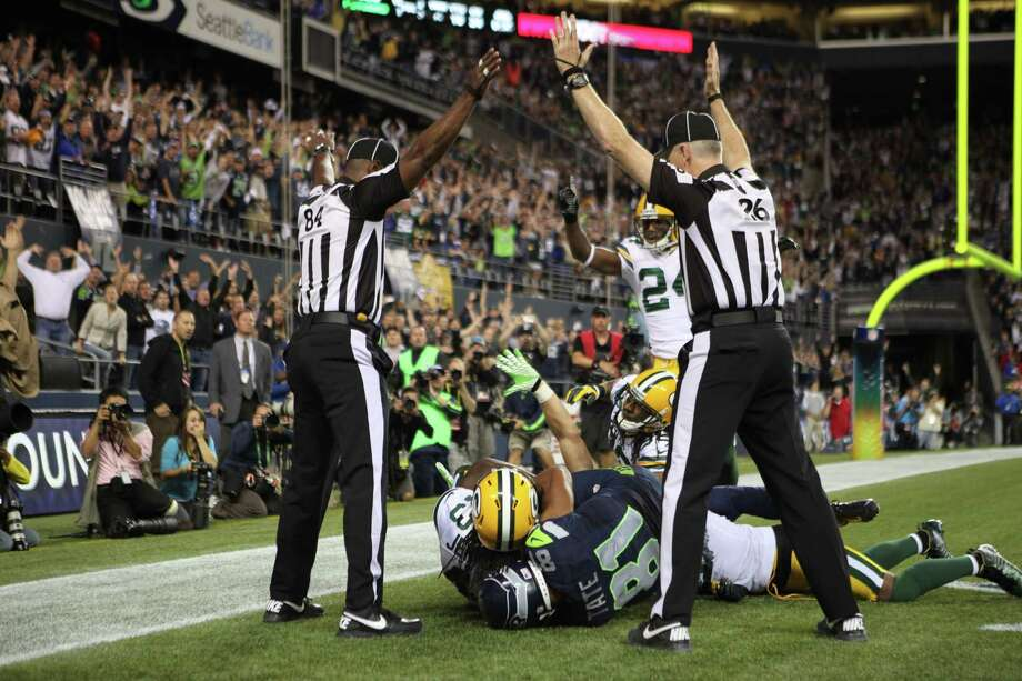 Refs signal TD for the Seahawks in a bizarre ending in the final play of the game against the Packers Monday. Photo: Otto Greule Jr / 2012 Getty Images