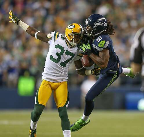 SEATTLE, WA - SEPTEMBER 24:  Cornerback Sam Shields #37 of the Green Bay Packers is called for pass interference against wide receiver Sidney Rice #18 of the Seattle Seahawks at CenturyLink Field on September 24, 2012 in Seattle, Washington. The Seahawks defeated the Packers 14-12.  (Photo by Otto Greule Jr/Getty Images) Photo: Otto Greule Jr, Getty Images
