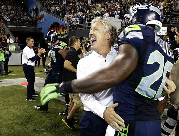 Seattle Seahawks head coach Pete Carroll, second from right, celebrates with Seahawks' Michael Robinson after defeating the Green Bay Packers 14-12 an NFL football game, Monday, Sept. 24, 2012, in Seattle. (AP Photo/Ted S. Warren) Photo: Ted S. Warren, Associated Press