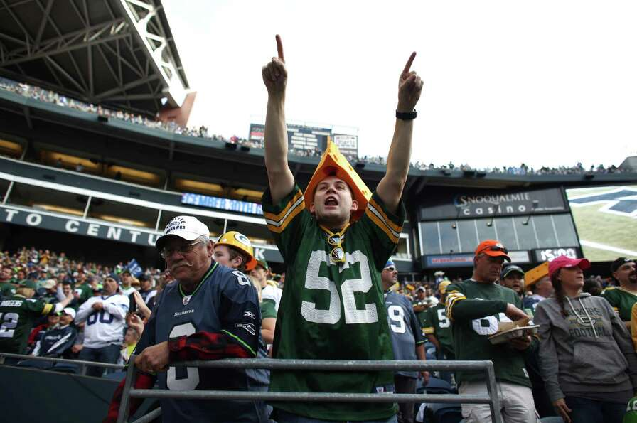 A Green Bay Packers fan cheers for his team during Monday Night Football against the Seattle Seahawk