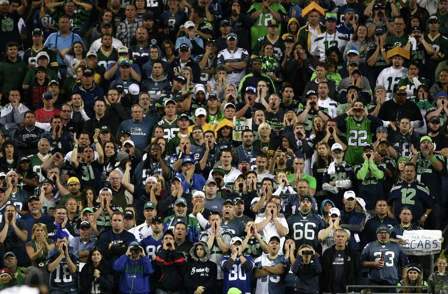 The 12th Man makes noise during a Green Bay Packers possesion as the Seattle Seahawks play the Packers during Monday Night Football on September 24, 2012 at CenturyLink Field in Seattle. Photo: JOSHUA TRUJILLO / SEATTLEPI.COM
